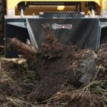Stump-Bucket-Skid-Steer-Loader-Attachment-Digging-a-Stump-_-Virnig-Manufacturing