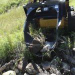 U-blade-Skid-Steer-Attachment-digging-up-rocks-_-Virnig-Manufacturing