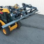 skid-steer-pipe-pallet-fork-grapple-action-2-virnig-manufacturing