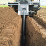 skid-steer-trencher-attachment-action-virnig-mfg-digging-trench